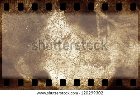 Grunge film strip frame on old paper sheet - stock photo