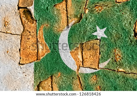 Grunge flag of Pakistan on old wall background. - stock photo