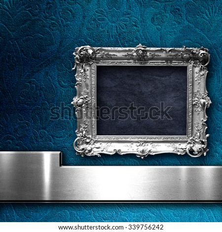 grunge floral faded wallpaper with silver vintage empty frame - stock photo