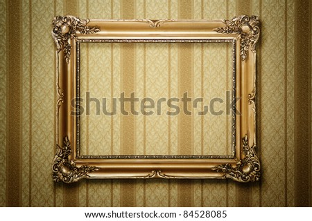 Grunge gold wooden frame on the striped wallpaper, clipping path included - stock photo