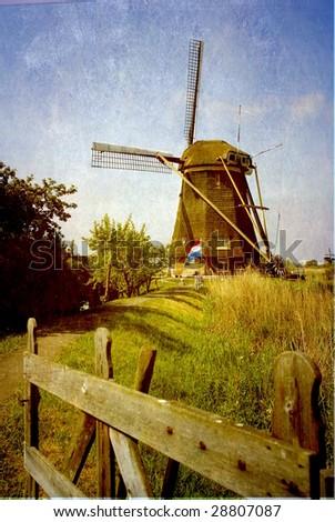 grunge image of a mill on kinderdijk - stock photo
