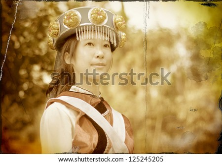 Grunge Image of a Pretty Chinese girl in the traditional clothes of the Naxi cultural minority