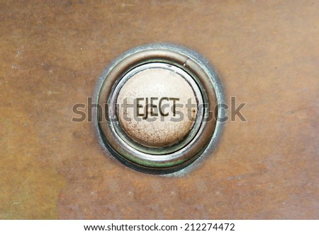 Grunge image of an old button - eject - stock photo