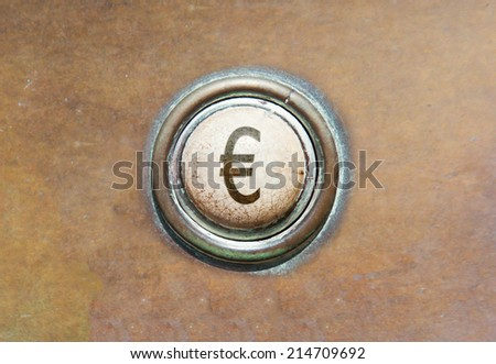 Grunge image of an old button - Euro - stock photo