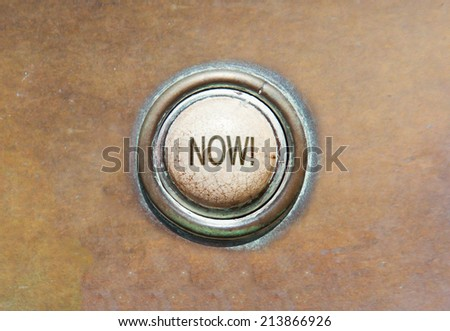 Grunge image of an old button - now! - stock photo