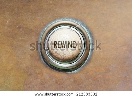 Grunge image of an old button - rewind - stock photo