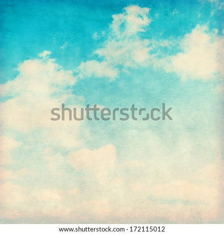Grunge image of blue sky with clouds.