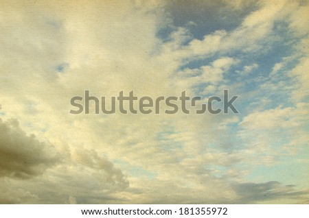 grunge image of blue sky with clouds