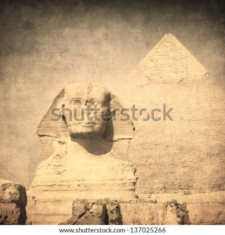 grunge image of sphynx and pyramid - stock photo