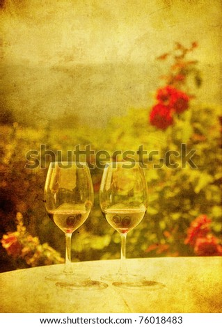 grunge image of two glasses of red wine