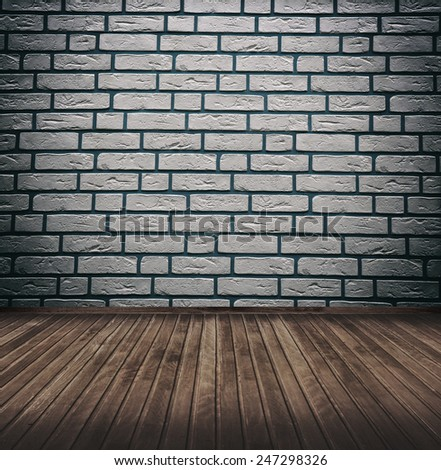 grunge interior room with brickwall and wooden floor. - stock photo