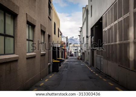 Grunge looking alley in Queenstown, New Zealand - stock photo