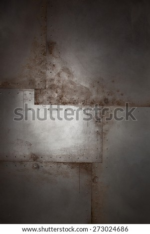 Grunge metal background with rivets and paint drips