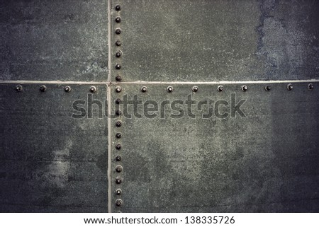 grunge metal background with rows of  bolts