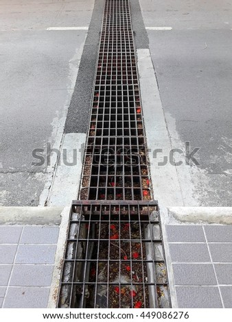 Grunge metal drain grate texture - stock photo