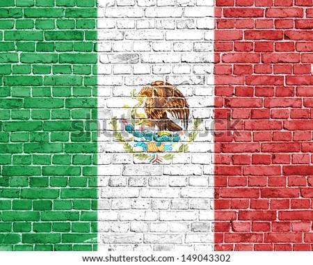 Grunge Mexico flag on brick wall - stock photo