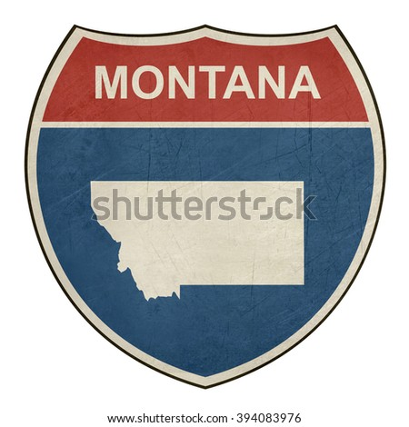 Grunge Montana American interstate highway road shield isolated on a white background. - stock photo