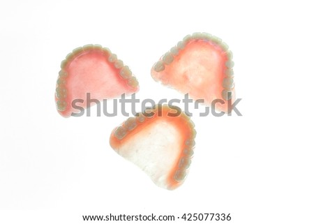 Grunge of denture on white background - stock photo