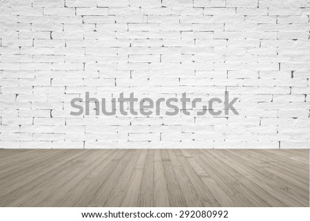 Grunge old aged brick wall painted in white color tone with wooden floor textured background in sepia brown color tone with vignette for interior backgrounds    - stock photo