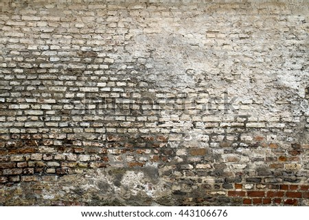 Grunge old bricklaying wall fragment. White red bricks and damaged plaster background texture for text or image. Close-up - stock photo