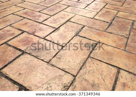Grunge Old Cracked Brown Brick Stone Street Road. Sidewalk, Pavement Texture Background - stock photo