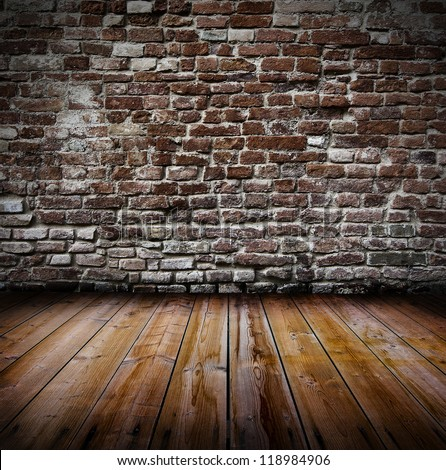 Grunge old interior with brick wall and wooden floor - stock photo