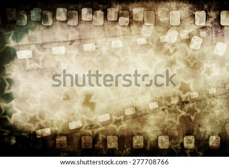 Grunge old motion picture reel with film strip and stars. Vintage background - stock photo
