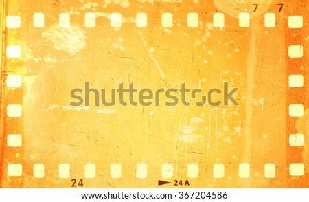 Grunge orange film strip frame. - stock photo