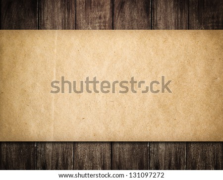 Grunge paper on wooden background - stock photo