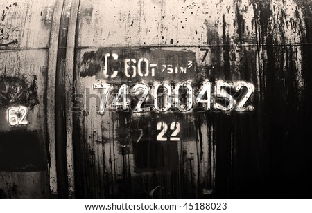 Grunge petroleum waggon with numbers - stock photo