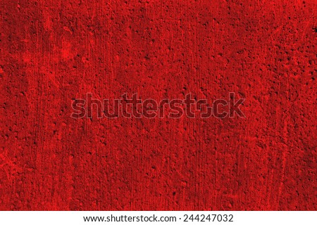 Grunge plaster cement or concrete wall texture red color with scratches - stock photo