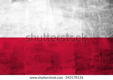 Grunge Polish flag on concrete wall - stock photo