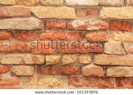 Grunge red brick wall texture of an abandoned house in Venice, Italy - stock photo