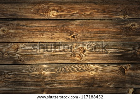 Grunge rich wood grain texture background with knots. - stock photo