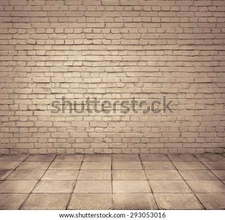 Grunge room interior with brick wall and tiled floor - stock photo