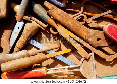 grunge rusty hand tools in messy arrangement - stock photo