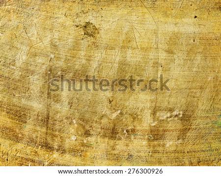 Grunge scratched golden texture - stock photo