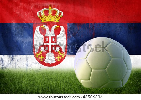 Grunge Serbia flag on wall and soccer ball - stock photo