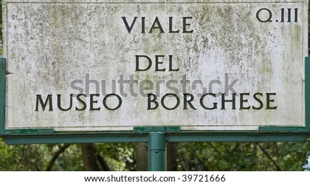 Grunge sign on alley to museum Borghese - Rome, Italy - stock photo