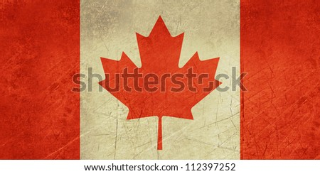 Grunge sovereign state flag of country of Canada in official colors.