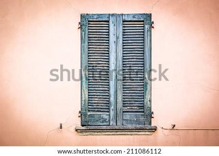 Grunge stile closed old window - stock photo