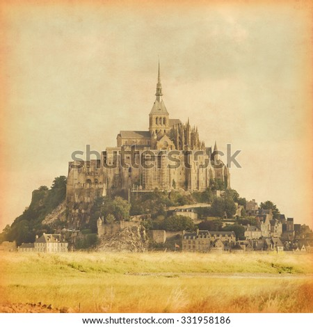Grunge style photo of Mont Saint Michel. Normandy. France. - stock photo