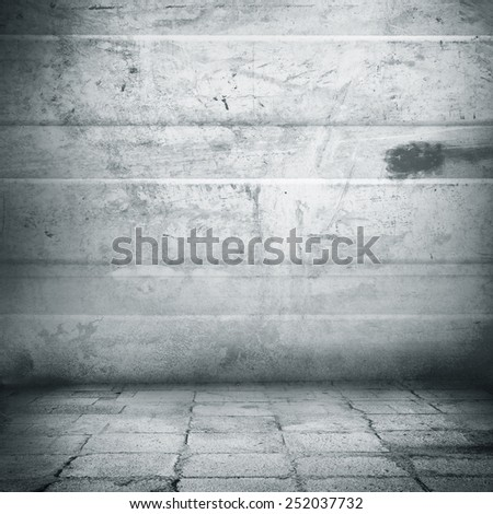 grunge urban background old metal wall texture and sidewalk, interior background - stock photo