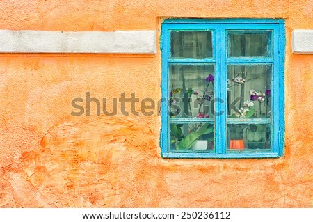 Grunge urban background texture aged old orange concrete wall with window - stock photo