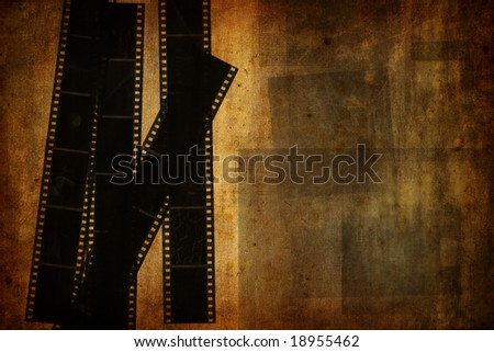 Grunge vintage background with used film strips - stock photo