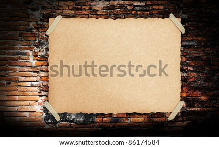 Grunge vintage old Brown paper on brickwall background - stock photo