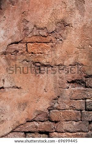 Grunge wall made of brick and mortar - stock photo