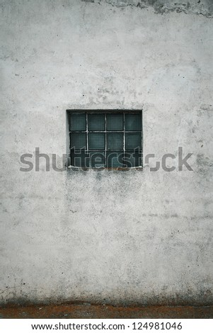 Grunge wall with a window - stock photo