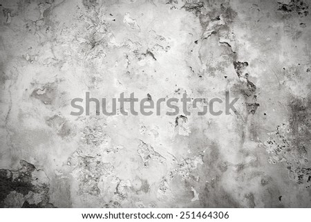 Grunge wall with peeling paint. Grungy background texture. Black and white retro style - monochrome color tone. - stock photo