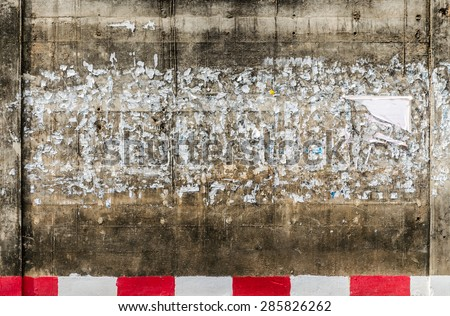 Grunge wall with posters - Urban grunge background - stock photo